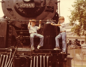 Dave and I in the early 70's on AT&SF 4-8-4 #2903.  NYC #999 in background.