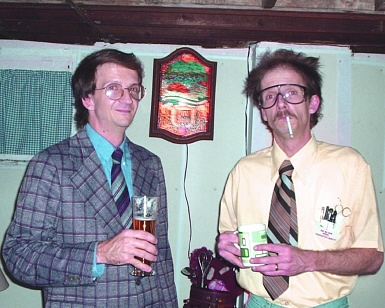 "Halloween: ""Funeral director"" and ""mad scientist"" -- with Heileman's Beer sign."